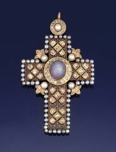 A LATE 19TH CENTURY STAR SAPPHIRE, DIAMOND AND PEARL PECTORAL CROSS PENDANT The centre set with an oval cabochon-cut star sapphire within a diamond border, the arms decorated with black champlevé enamel applied with old cushion-cut diamond quatrefoil clusters, the border set with mauve tinted pearls with diamond and white pearl cusp intersections, on a diamond and pearl cluster suspension loop, the reverse with floral engaving, circa 1890