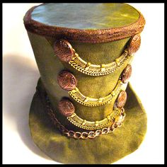 Love the adornments on the hat. A couple of bracelets and buttons could recreate it.