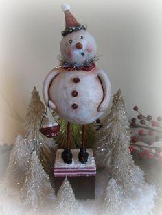 Folk Art Paper Clay Snowman Sculpture. $55.00, via Etsy.