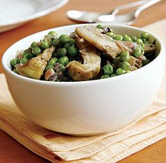 Because fresh, tender peas don't arrive in my local markets until the spring artichoke harvest is winding down, I usually make this dish with frozen peas. If you use fresh peas, they'll need more coo. Peas And Prosciutto Recipe, Vegetable Dishes, Vegetable Recipes, One Skillet Meals, Artichoke Recipes, Frozen Peas, Easy Weeknight Dinners, Daily Meals, Greek Recipes