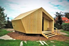 Prefab cabin designed for campers is highlighted by compact and efficient design.