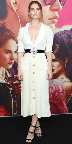 Lily James took the plunge at the Australian premiere of Baby Driver, wearing a white coat dress with a gleaming diamond belt and frills galore. The actress kept it sweet in a pair of strappy heels adorned with tiny bows.