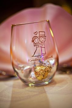 Personalized 9 oz Stemless Wedding Wine Glasses 9 oz stemless wine glasses are available in of design and color combinations. Use them at dessert buffets for guests to hold their candy and then they can take them home as little favors. Karishma & B Creative Wedding Favors, Wedding Gifts For Guests, Wedding Favors For Guests, Personalized Wedding Favors, Wedding Giveaways For Guests, Personalized Invitations, Wedding Tokens, Wedding Favor Boxes, Wedding Table