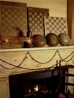 Wooden bowls, game boards, fireplace, cranberry string(?)..... comfy primitive look