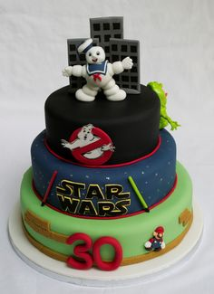 1980s theme birthday cake with Ghostbusters, Star Wars and Mario toppers