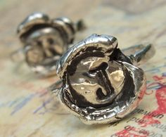 For this wax-seal, silver monogram ring, an initial is stamped into the silver, with the edges oozing out as it would with wax. (So says the artist, HappyGoLicky, on Etsy.)