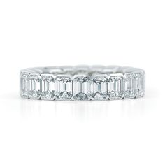 The graceful line of a polished edge embraces chic emerald cut diamonds in a side-by-side orientation. The design of the brilliant eternity ring evokes a modern feel.  - See more at: http://www.kwiat.com/fine-diamond-jewelry/emerald-cut-diamond-eternity-band-bezel-setting-platinum/p/58158/100/0/0#sthash.0Sch6WWv.dpuf