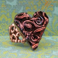 Handmade Raku Heart Set On Copper Colored Brass by oscarcrow, $18.00