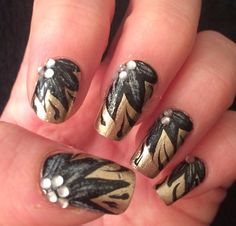 Gold and black flowered nail art