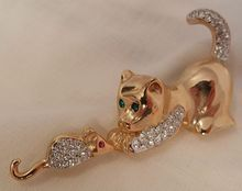 Todays new arrivals Big plaza shop 3 day sale 20% off storewide 3 day sale ends 8/26 discount given at purchase or refunded after.Check My Lane shop for august sale many items 20 to 60% off links on home page   You will love this Cat and Mouse game rhinestone Brooch Marked AFJ  Made in Canada