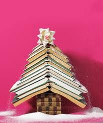Small Christmas tree made from old books.. Love the snow!