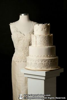 Lace on cake matches the bodice of the dress