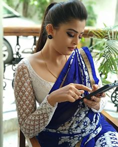 In a dark blue & white color saree and sheer / netted full sleeve blouse design White Blouse Designs, Full Sleeves Blouse Designs, Saree Blouse Neck Designs, Silk Saree Blouse Designs, Net Saree Designs, Blouse Patterns, Sleeve Designs, Stylish Blouse Design, Blouse Models
