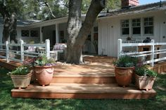 : Deck Details: a nice over sized landing on an angle for pots and flowers and it really helps to invite you to come on up and sit under the trees...