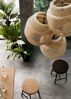 Bamboo cut lighting fixtures and cork bar stools. With numerous designs, shapes, colours, dimensions or lighting abilities, lamps constitute one of the most convenient methods one has to alter the lighting tone of a room. #urbandesignfox #lighting #lightingideas #urbandesign