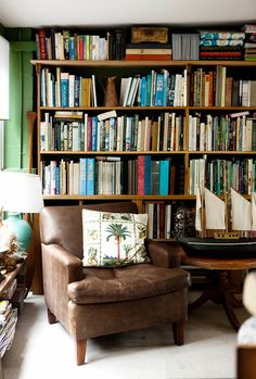 The home library in this new build in Queensland features green walls and an antique leather armchair. Dining Room Table Chairs, Living Room Chairs, Salon Chairs For Sale, Outdoor Wicker Chairs, Accent Chairs Under 100, British Colonial Style, Adirondack Chairs For Sale, Home Libraries, Furniture Dolly