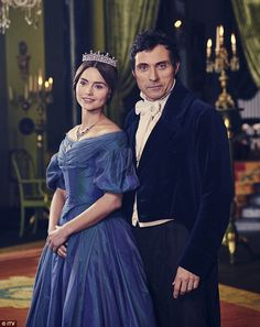 One shot from the ITV series showed Jenna, 30, in a tiara and royal blue dress as she cosied up to Rufus Sewell - who plays former Prime Minister Lord Melbourne