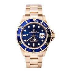A gents 18ct gold Rolex submariner from 1989. This magnificent watch features a deep blue dial, a matching bezel, a depth rating of 1000ft and a date panel at the three o'clock position. #vintagewatch #rolex #goldwatch