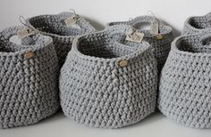 Crochet hanging basket from grey cotton cord storage