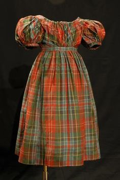 *    Boy's Tartan Dress, c.1833-1835 - Wool, woven check, bodice lined red silk Young boys wore a form of dress or tunic with a pleated skirt, often of chequered wool, up to the age of seven.