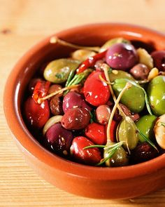 "Mixed Olives (such as Alfonso, kalamata, nicoise, and red and green Cerignola) with Caper Berries _ This recipe for mixed olives is adapted from ""Martha Stewart's Hors d'Oeuvres Handbook."""