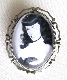 Bettie Page Cameo Brooch and Pendant. $10.00, via Etsy.