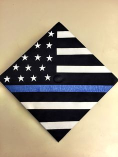 My boyfriend plans on going into law enforcement sometime after graduation and dedicated his graduation cap to all the officers who protect our communities past present and future. Graduation Cap Images, Graduation Cap Designs, Graduation Presents, Graduation Cap Decoration, Graduation Caps, College Graduation, Criminal Justice Graduation, Grad Hat, Blue Line Flag