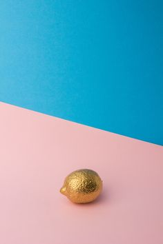 I like the composition of André Britz's images. The use of contrasting bright block colours as a backdrop and the use of odd objects such as this gold lemon as the forefront.