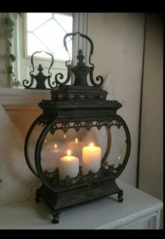 This Candle Lanterns are incredible at making your home a marvelous place. Lanterns Decor, Candle Lanterns, Candle Sconces, Indoor Lanterns, Lantern Candle Holders, Candle Lamp, Chandelier Bougie, Chandeliers, Wrought Iron Decor