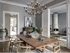 The FLOS 2097 pendant light adds modern sophistication to this spacious dining room with wood seating and a wood table. Living Room Inspo, Decor, Interior Design Living Room, Rustic Dining Table, Living Dining Room, Dining Room Inspiration, Interior, Home Decor, House Interior