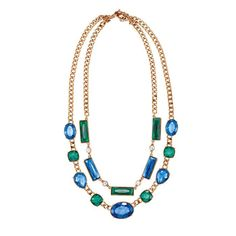 Two strands of absolutely fabulous! This layered necklace brings a new meaning to statement piece. White green and blue rhinestones are set in beautiful goldtone chains.Introducing Fireworks Collection: Light up the night in this eye-catching mix of green, blue and decadent goldtone. Complete the look with the Fireworks Earring Gift Set, Fireworks Flex Bracelet and Fireworks Cocktail Ring.FEATURES