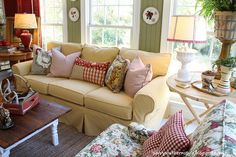 Love the color of the couch and the red accents.