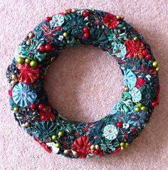 Suffolk puff/yoyo Christmas Wreath with a few added bits