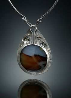 Montana Agate Centerpiece. Fabricated Sterling Silver and 18k Gold.  www.amybuettner.com https://www.facebook.com/pages/Metalsmiths-Amy-Buettner-Tucker-Glasow/101876779907812?ref=hl https://www.etsy.com/people/amybuettner http://instagram.com/amybuettnertuckerglasow