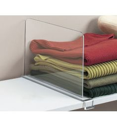 This Acrylic Shelf Divider keeps stacks of clothing towels books and more neat and organized. Designed to be used like book ends these dividers provide a clean look and help bring order to the clutter in any closet. The acrylic shelf dividers simply clip on to a wood shelf or any solid material shelf up to 3/4 of an in