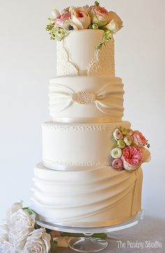 ivory fondant 4 tier wedding cake with swags and flowers by the pastry studio