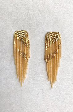 Beaded fringe statement earrings in gold and topaz. Handmade in Austin, Texas, by Betty Alida. Semi translucent glass beads are make these the perfect Summer 2019 statement earrings! Seed Bead Jewelry, Sea Glass Jewelry, Crystal Jewelry, Beaded Jewelry, Glass Beads, Diy Jewelry, Jewelry Ideas, Jewelry Findings, Diamond Jewelry