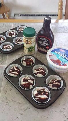 Yield: 12 servings; 1 point per serving 1/3 C. PB2 (7 Tbs. mixed with water) 1 container FF Cool Whip 4 Tbs. Lite chocolate syrup Mix the PB2 with cool whip. Pour into lined muffin cups. Drizzle w/ chocolate syrup on top. Freeze.