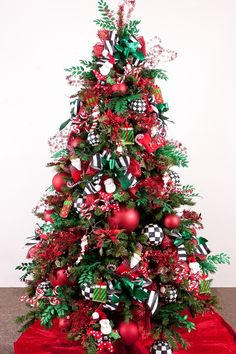 Christmas Tree-Winter Whimsey-POP the traditional red and green norm with Black and White! Zebra stripes, checks and polka dot ribbon-add in your favorite snowmen. Get your Winter Whimsy ribbon, balls, and floral now- http://www.showmedecorating.com