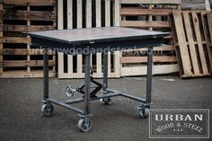 Urban Industrial Drafting Table constructed from 4 inch channel iron, reclaimed pine, scissor jack, threaded rod and 5 inch casters. unit size 50w x 33d x 36h - 42h (angle) ************************************************************************************ Please read our shipping policies