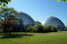 Mitchell Park Horticultural Conservatory  (The Domes) is a conservatory located at Mitchell Park in Milwaukee, WI. Each of the 3 domes (Tropical, Arrid & Show) maintain a distinct climate & setting for the exposition of its large variety of plant life. At a bluff overlooking the Menomonee Valley, is a monument marking the site of an early trading post built by Jacques Vieau, who was a settler & fur trader who later became father-in-law to Milwaukee founder Solomon Juneau.