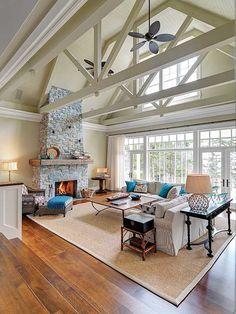 Exposed beams - like a barn but a really, really nice barn. Light airy living room