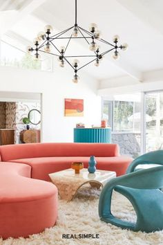30 Easy and Unique Living Room Decorating Ideas | Don't be afraid to introduce dramatic bursts of color. Take a cue from Bells+Whistles design and pair statement furniture pieces with clean lines and white walls for balance. #realsimple #livingroomdecor #livingroomideas #details #homedecorinspo Cozy Living Rooms, Living Room Interior, Living Room Decor, Minimalist Interior, Whistles, Other Rooms, White Walls, Palm Springs, House Colors
