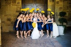 yellow bouquet w/ navy dresses