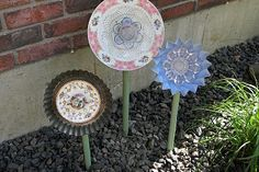 I made flowers out of various dishes and china. Plus metal pipe and I… :: Hometalk