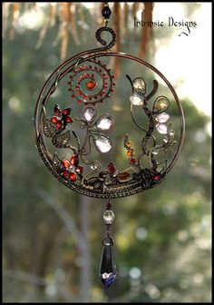 Multi Gemstone Wirewrapped Suncatcher sparkling in the morning light. By Cathy…