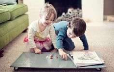 Roll away chalk board/play table - stores under the couch