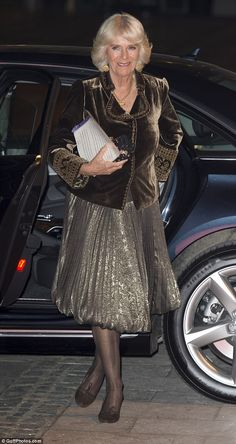 Rehearsing her lines? Camilla may have been getting some practice in during the car journe...