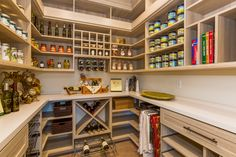 This custom kitchen pantry design features an array of organizational elements, from cubbies for spices, a hanging section for table clothes, to crosshatch wine racks.   Learn more here: https://www.closetfactory.com/pantry-wine-cellars/