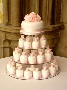 Everyone can have their own mini cake and bride and groom have theirs to cut into.